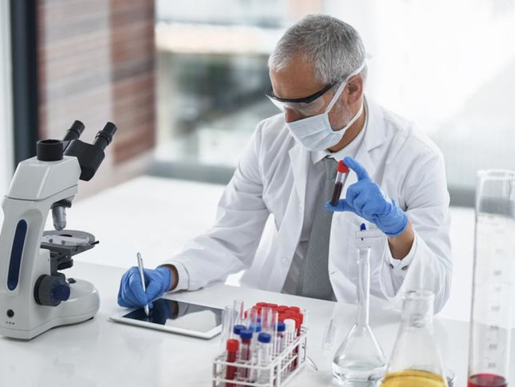 Man in lab coat working