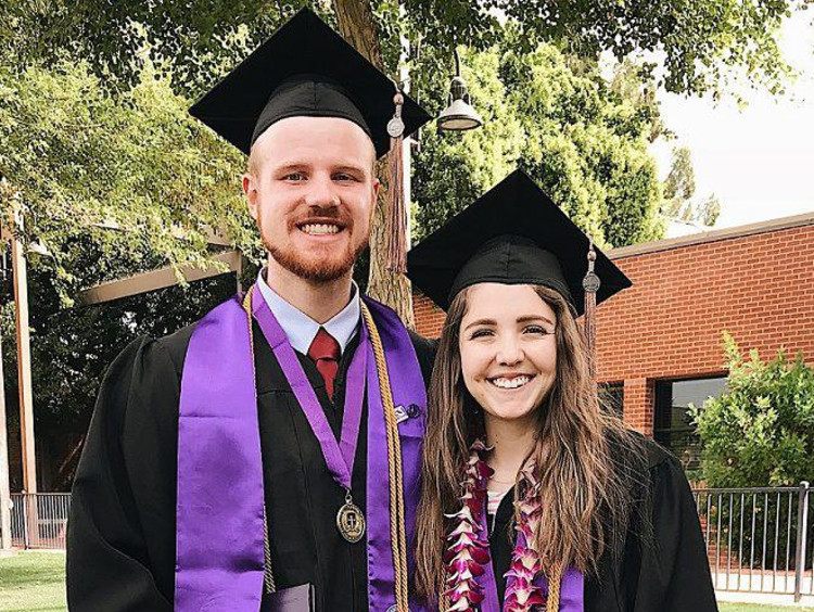 two GCU students wearing a cap and gown