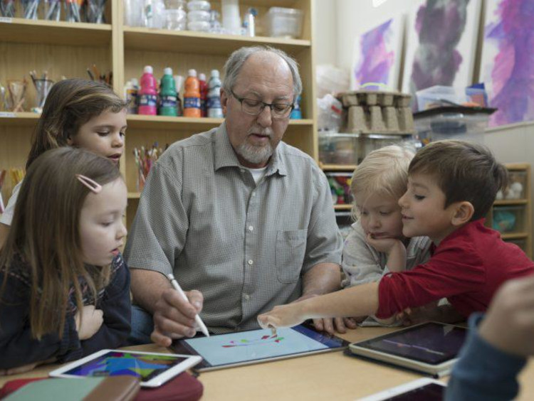 Instructor teaching students on a tablet