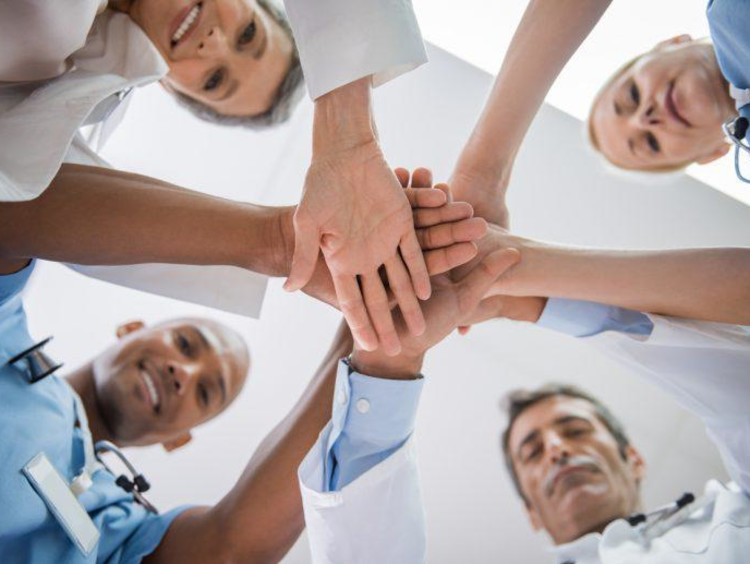 Team of nurses in a huddle