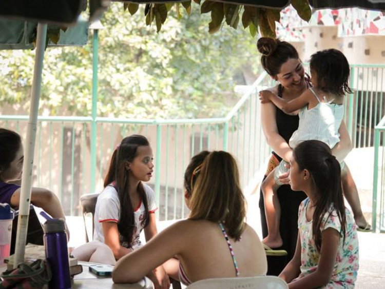 Filipino girls seated at a table during a global outreach trip