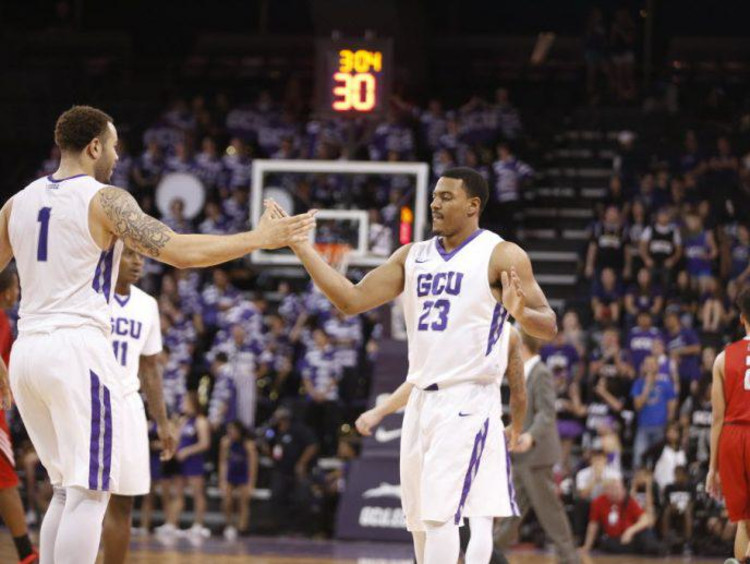 gcu basketball players giving each other a high five