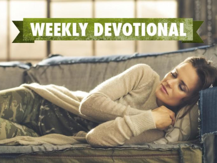 A student sleeping on the couch under a Weekly Devotional banner