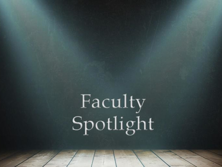 Faculty spotlight text center stage with spotlights on the text
