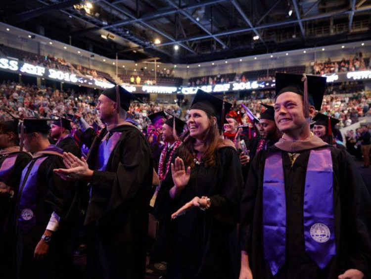 Group of excited honors college graduates at ceremony