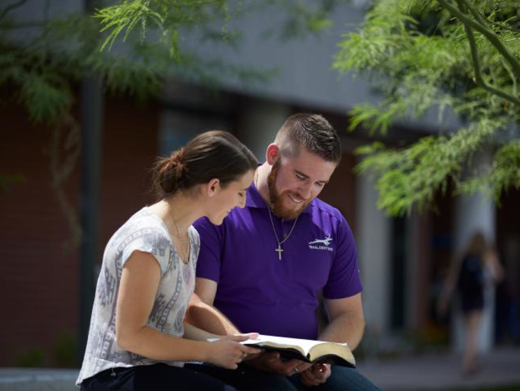 man and woman studying outside