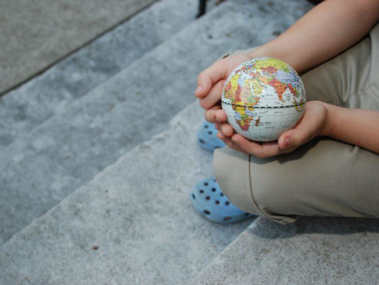 child holding a mini globe