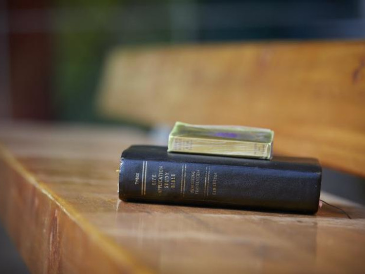 bible resting on a bench