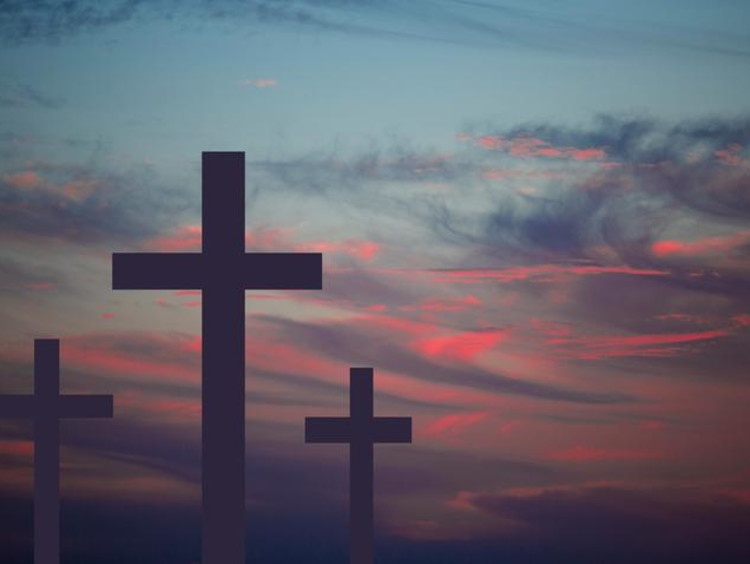 A hilltop of crosses at sunset