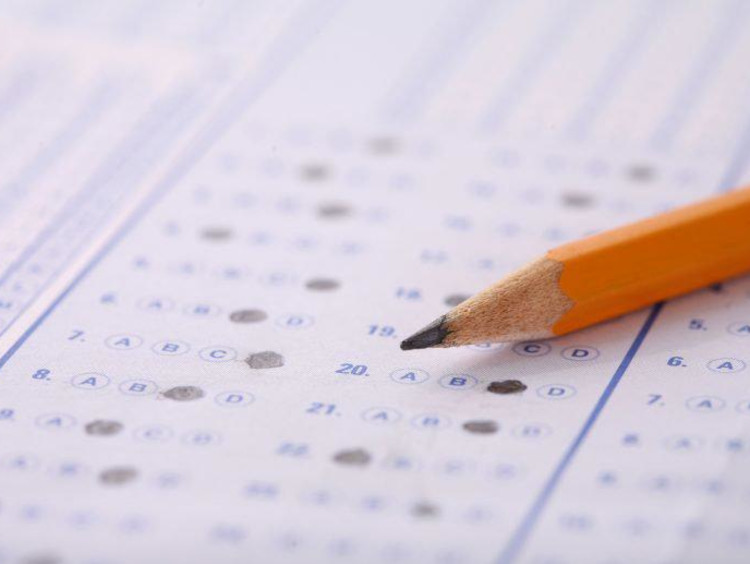Pencil resting on top of a standardized test