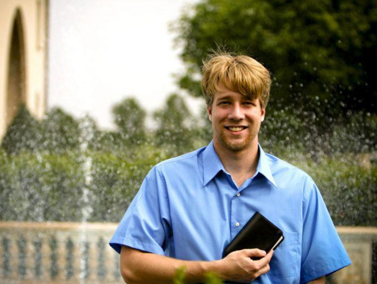 A seminary student holding the Bible outside