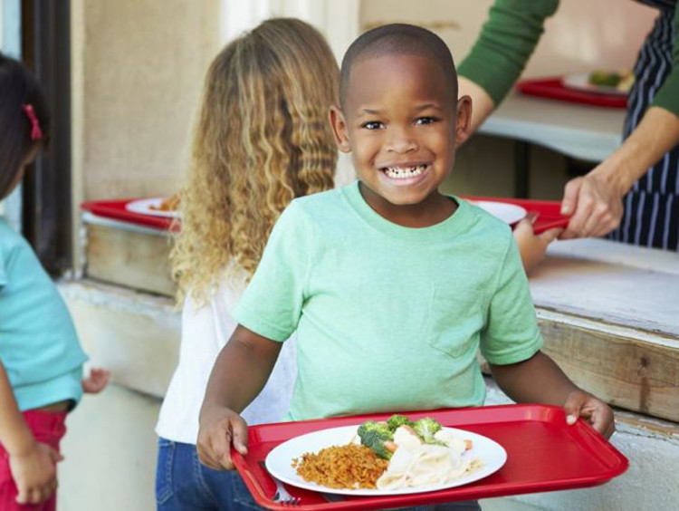 student eating a school lunch