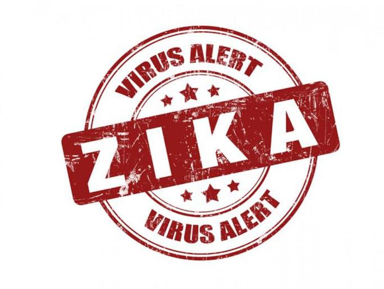 "A red virus alert sign reading ""Zika"""