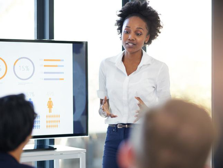 Woman gives marketing presentation during a meeting