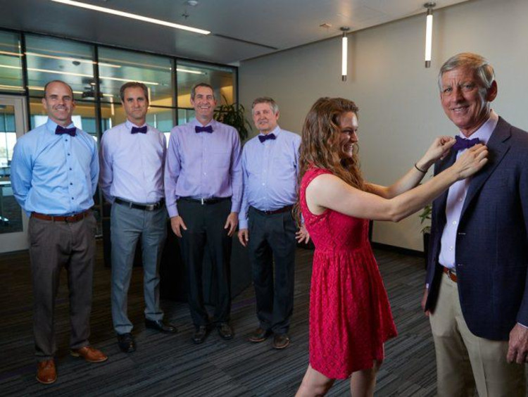 Brian Mueller and other members of the leadership team with Andrea Northup of bowtie business.