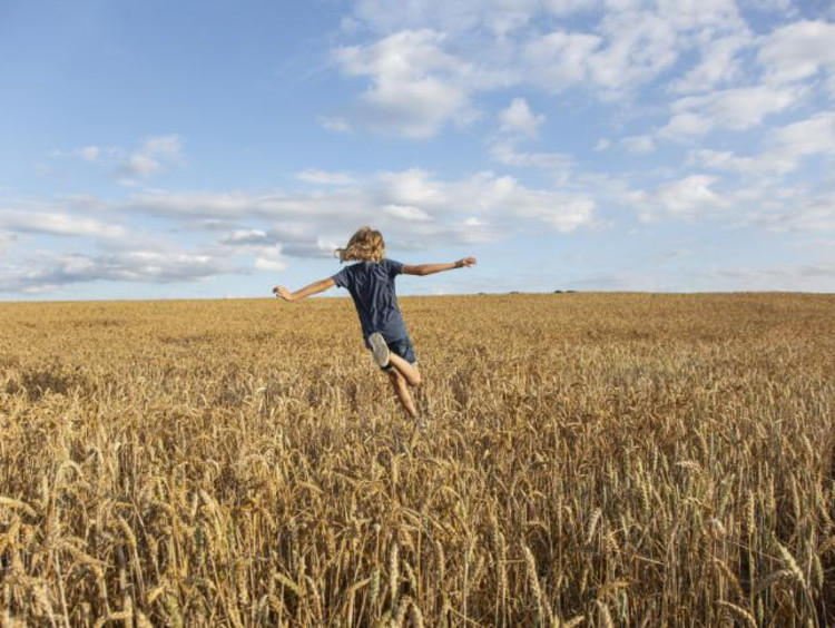 a girl running through a field