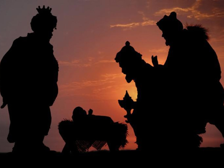 The three kings bringing gifts to baby Jesus