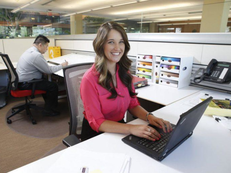 young woman working at her desk in an office