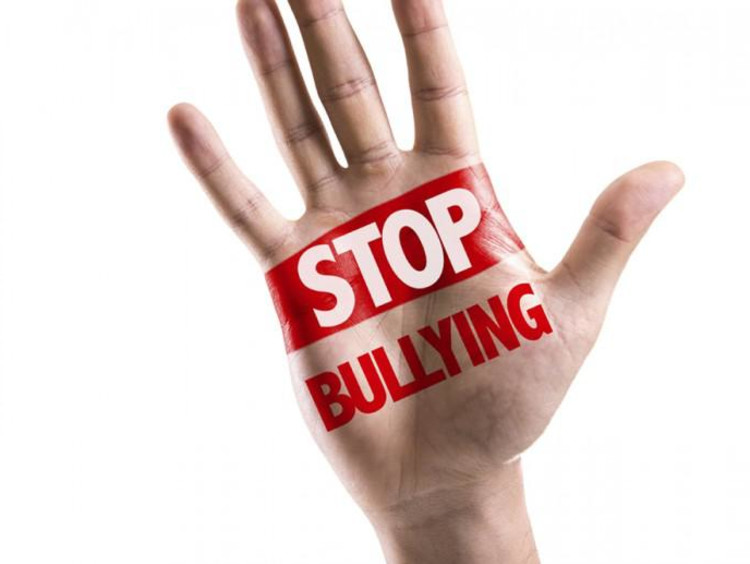 a hand that says stop bullying on it