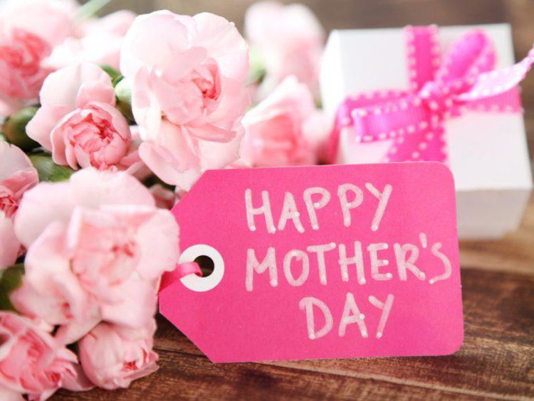 Hot pink Happy Mother's Day tag with lighter pink flowers and gift in background