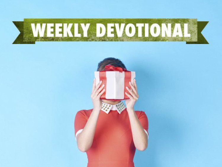 Weekly Devotional: Woman hiding behind a present