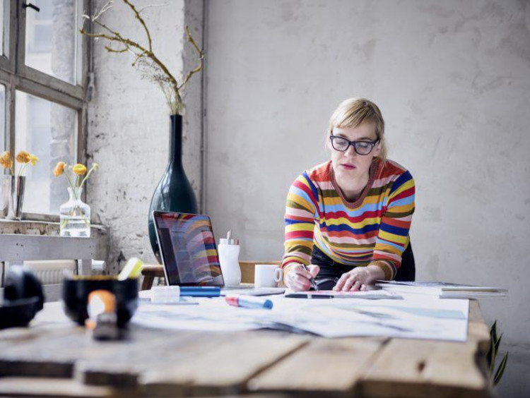Portrait of woman working at desk in a loft