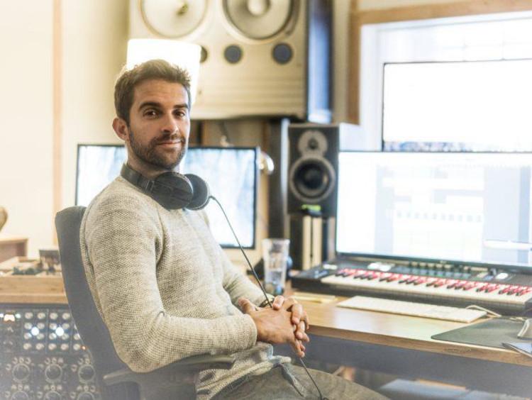 DJ sitting at a desk