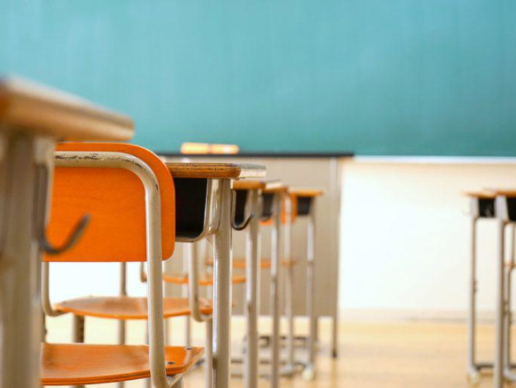 Empty classroom row of desks