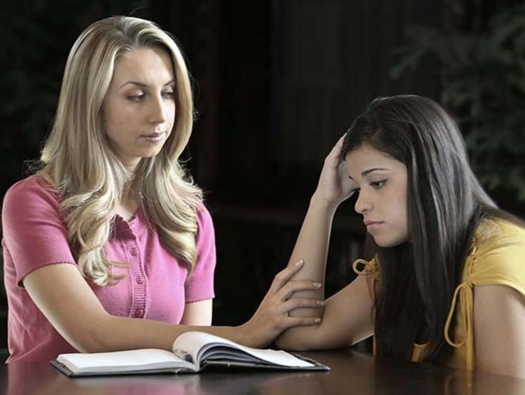 Women comforting an upset friend