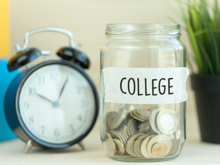 change in a jar labeled college and an alarm clock