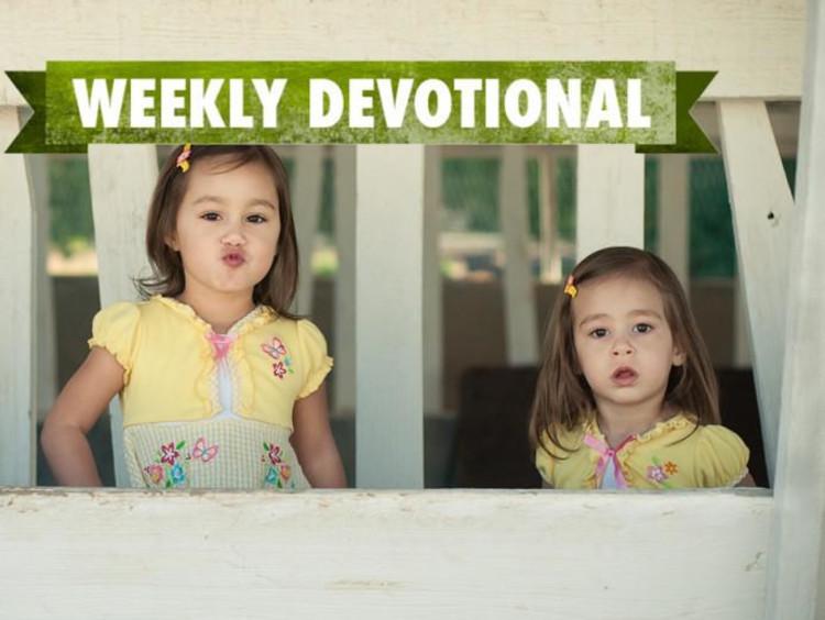 Two girls below the green weekly devotional logo