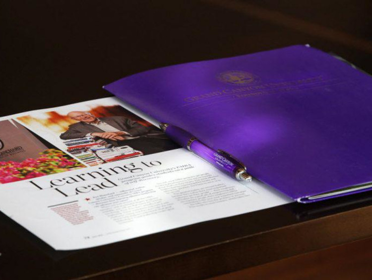 """gcu folder next to article """"learning to lead"""""""
