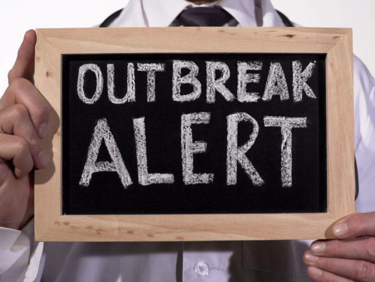 sign that says outbreak alert