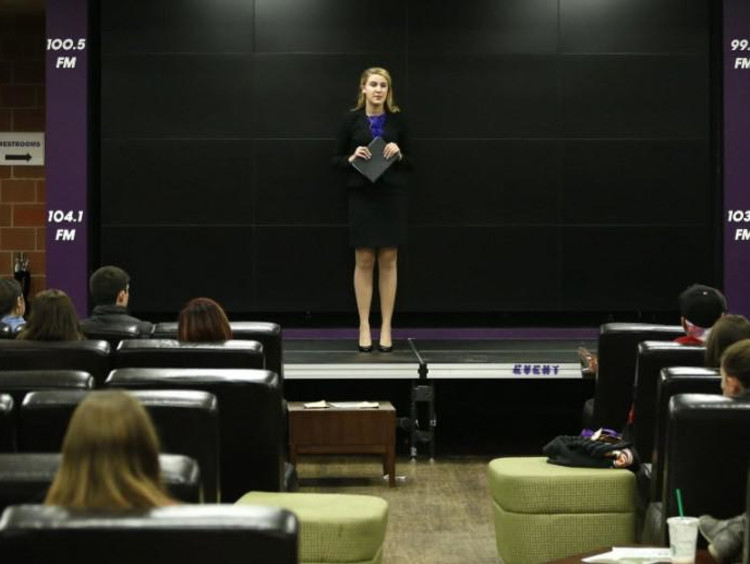 Woman standing up at pdium