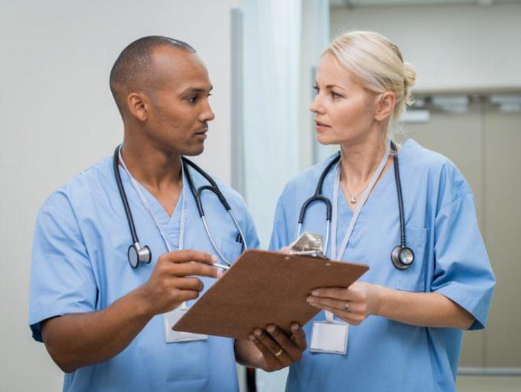 two nurses talking