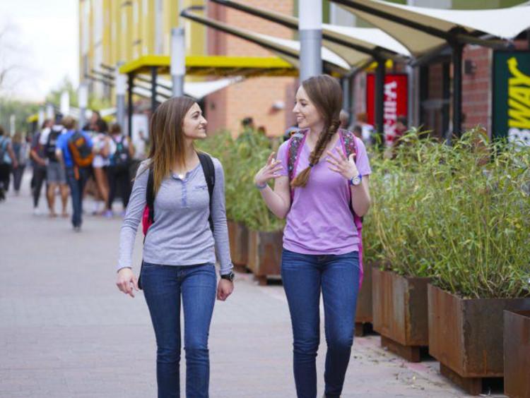 Two GCU girls walking on campus
