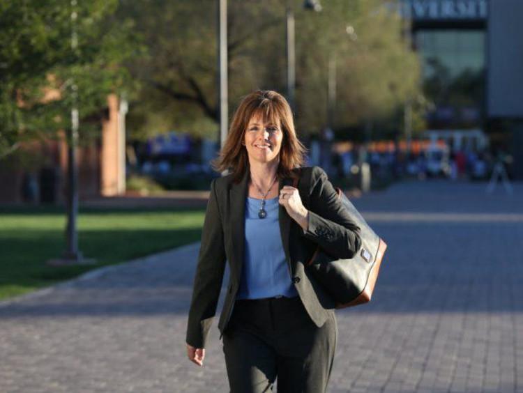 Doctoral Learner walks on campus