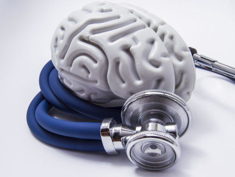 Stethoscope surrounds fake white brain