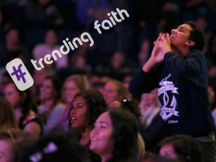Female student worshiping during Chapel with hashtag trending faith
