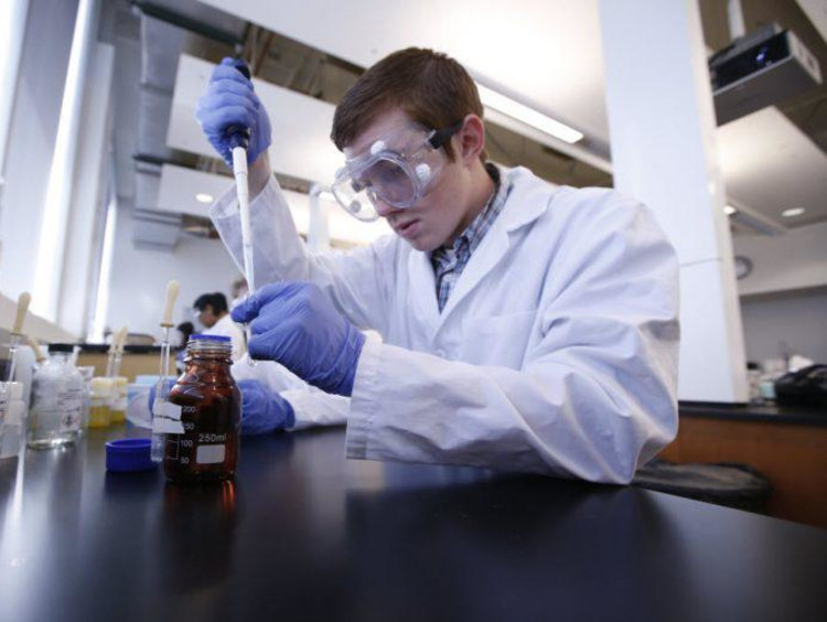 chemistry student working in a lab