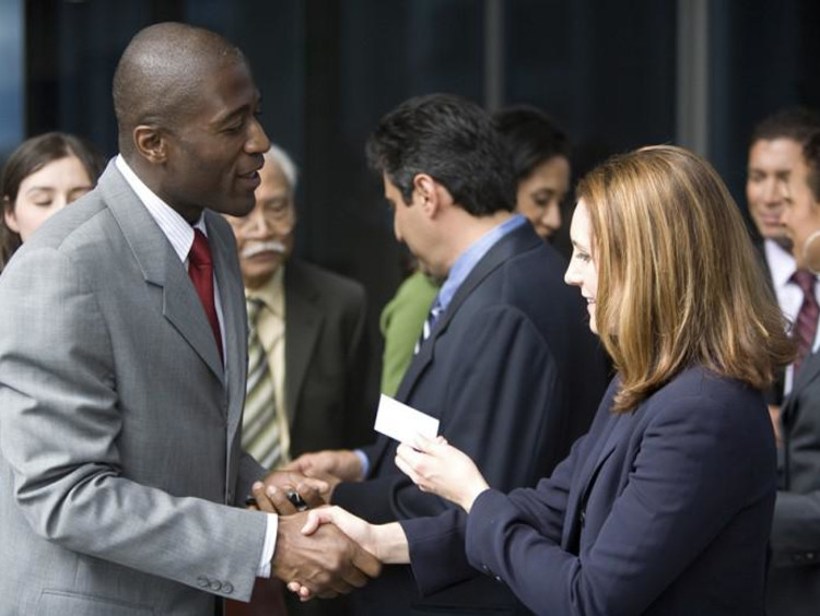 two business people exchanging business cards