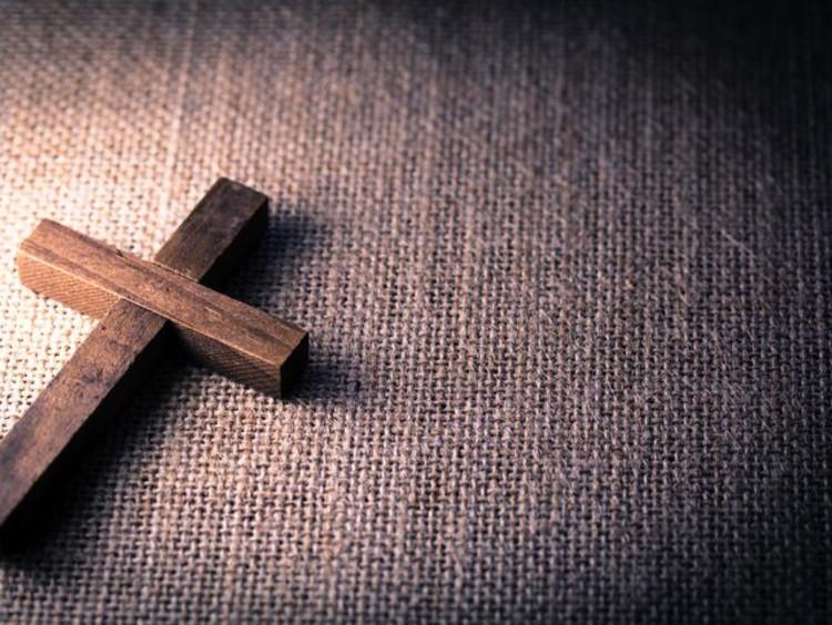A wooden cross on the floor