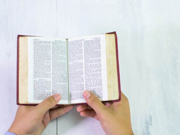 Bible and Hands