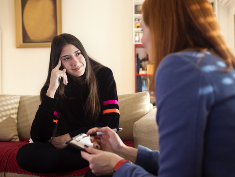 A psychologist counseling a patient