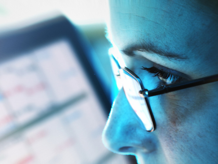 close-up of woman looking at computer in office
