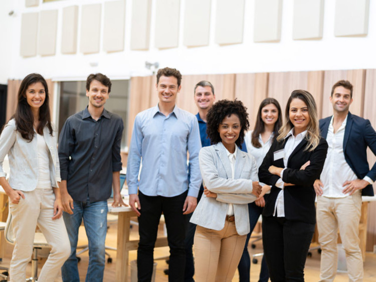 Business people standing and smiling