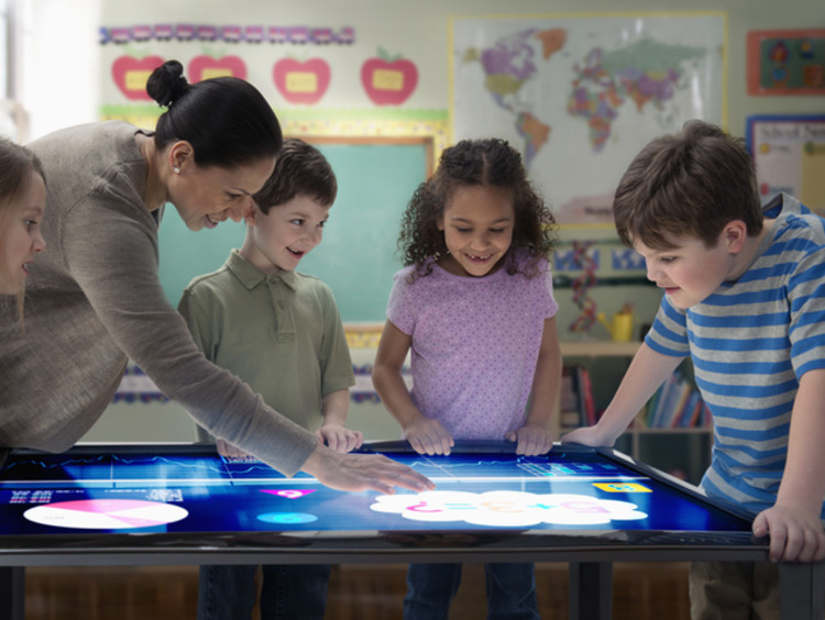 Diverse students interacting with an electronic map