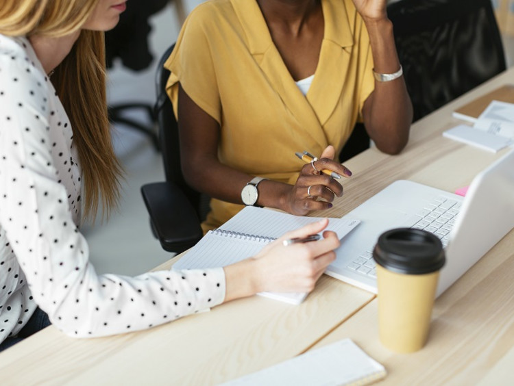 Woman working with a mentor