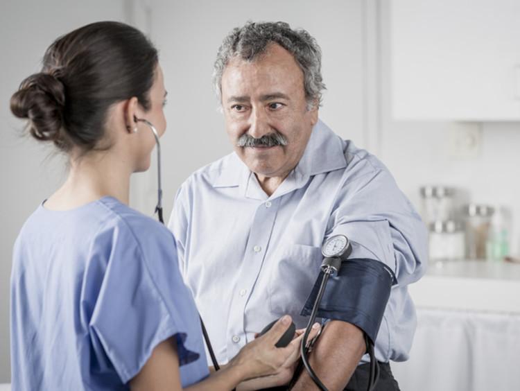 Nurse takes a patient's blood pressure