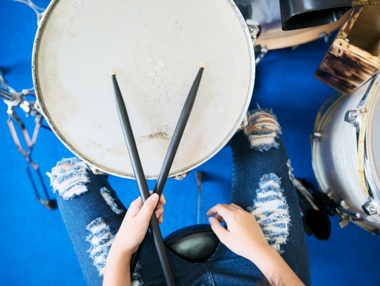 a person playing on the drums